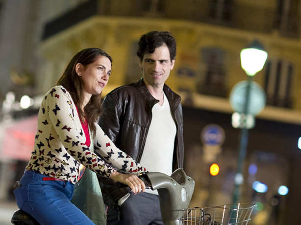 Visual of couple in a lighted city