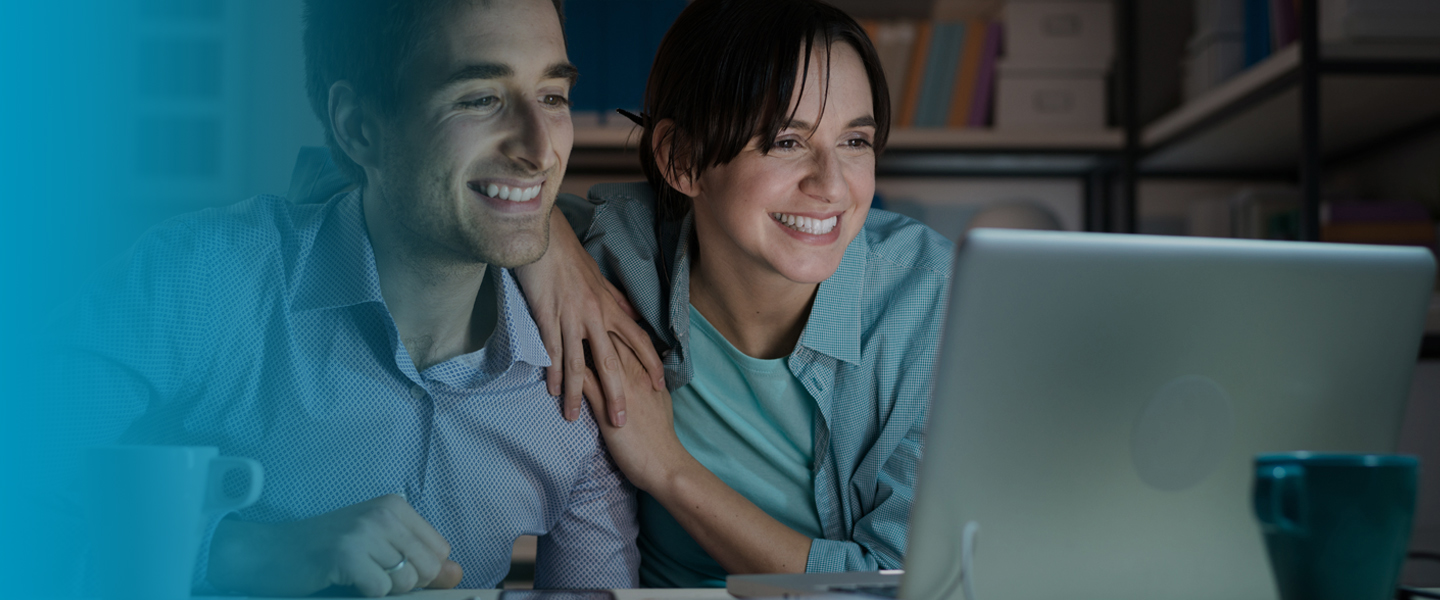 Picture of couple using internet at home