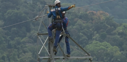 Technicians operating on power line